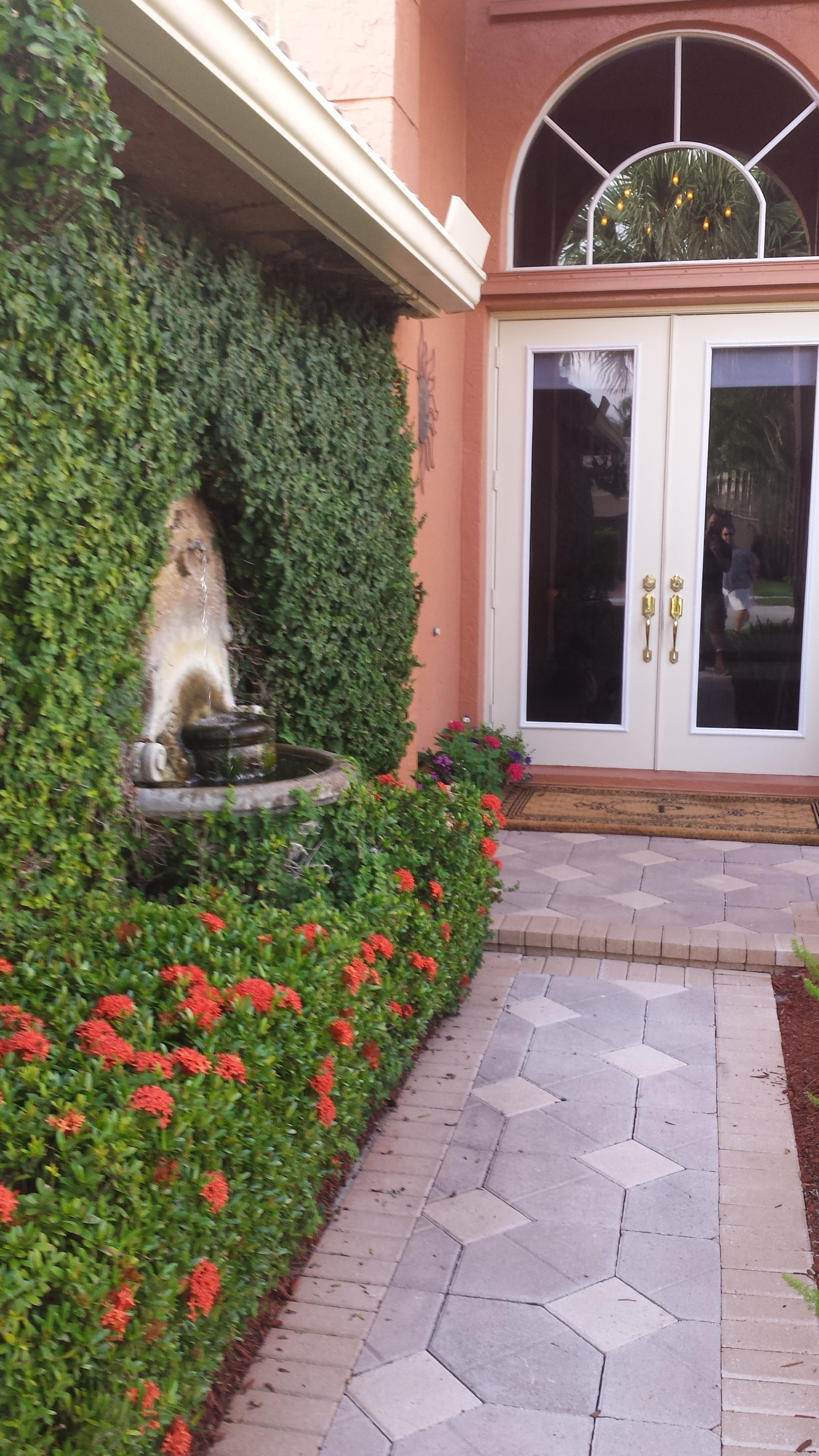 Front Entry Landscape Design With Small Fountain