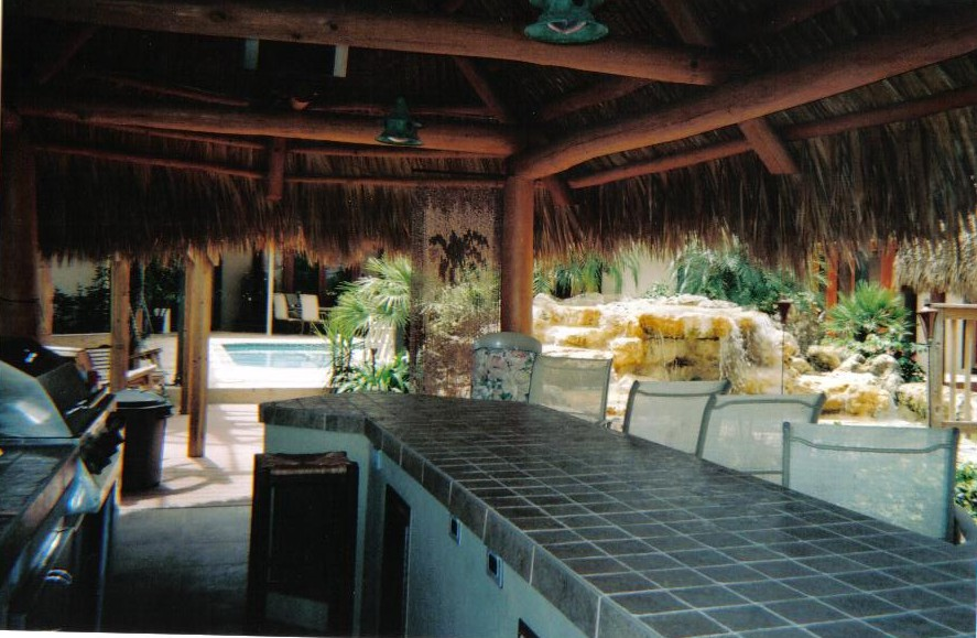 backyard makeover, waterfalls, outdoor kitchen, landscape tiki huts.