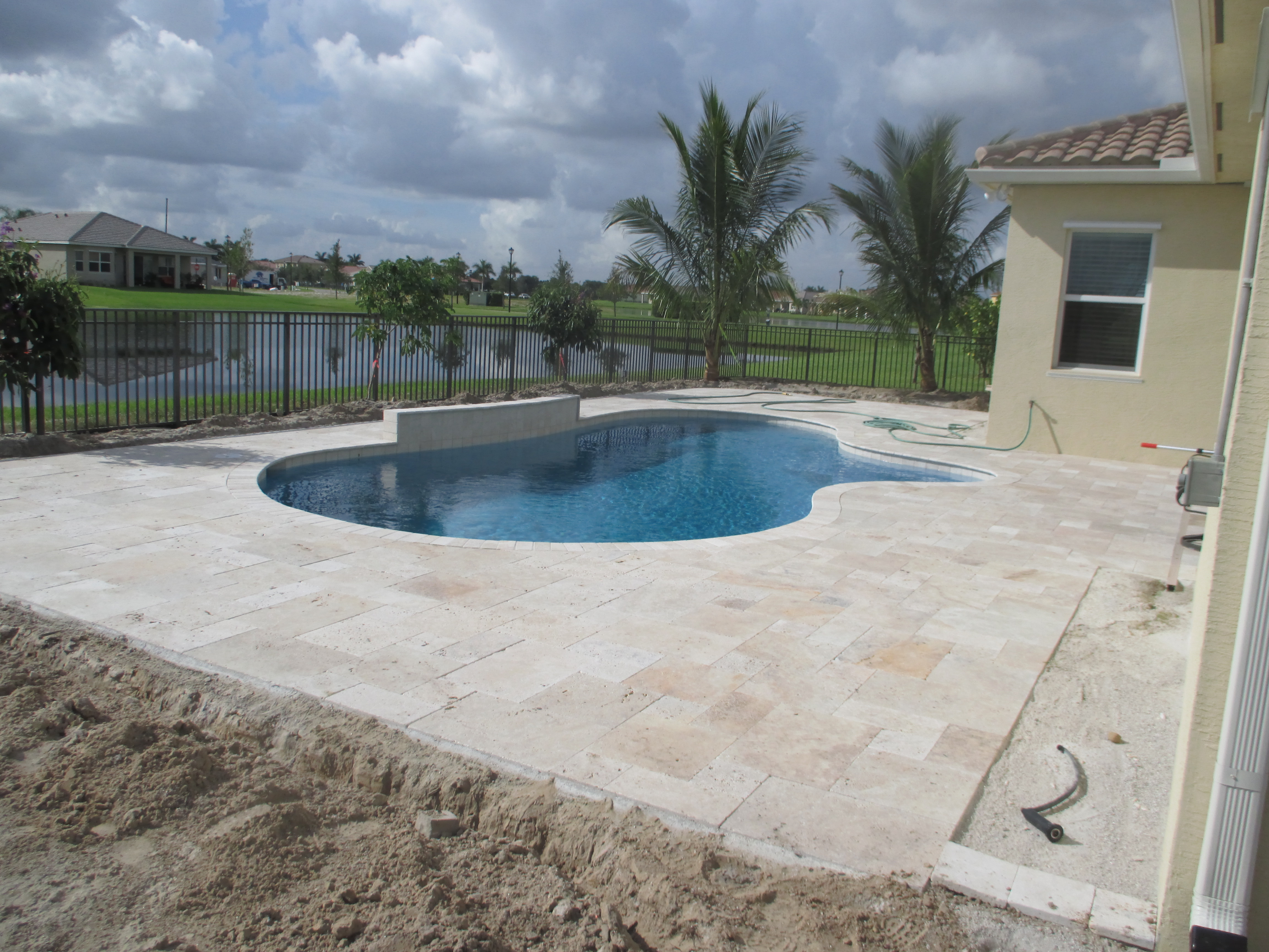 Landscape for new swimming pool during installation royal palm beach universal landscape inc - Palm beach swimming pool ...