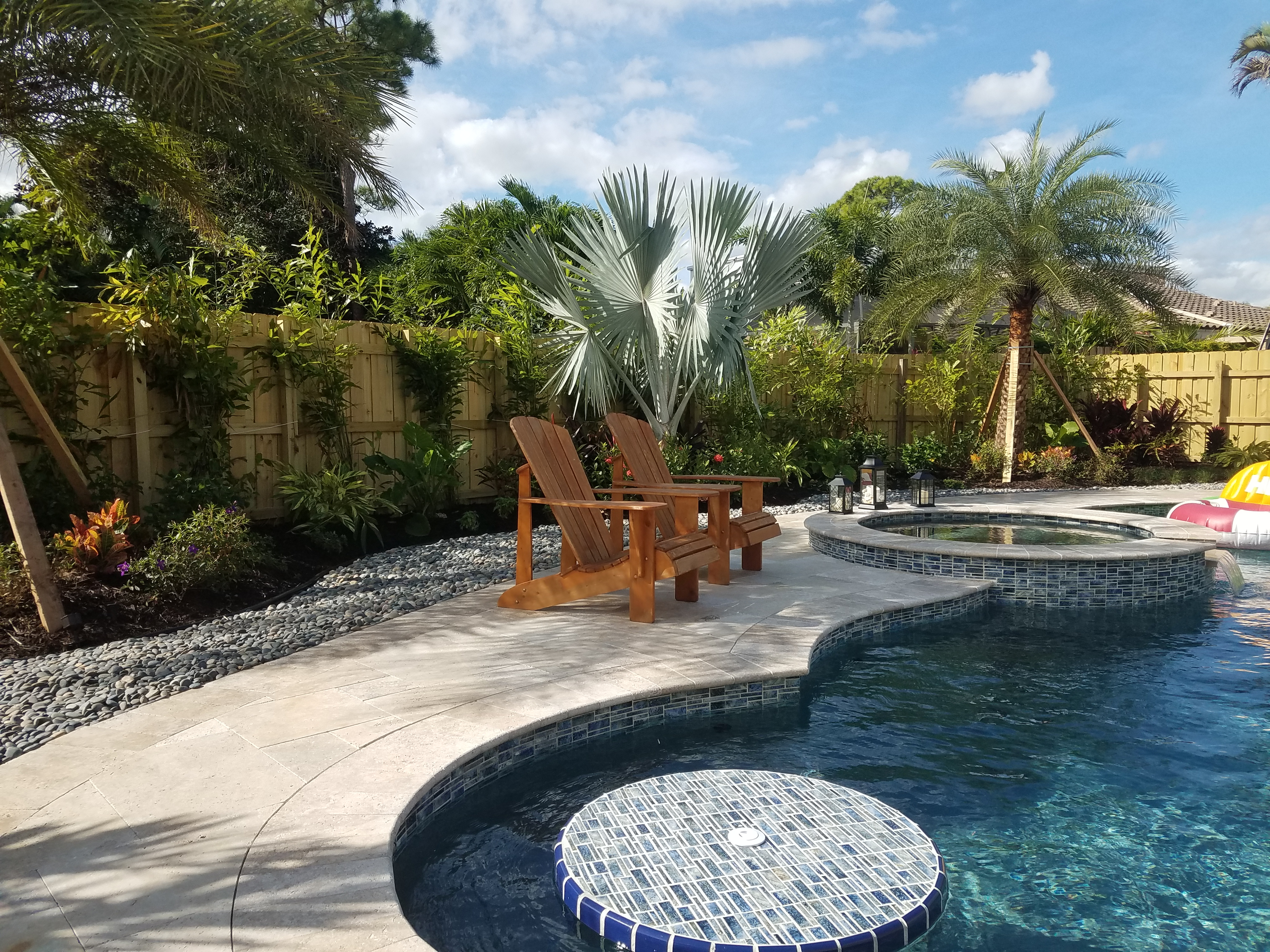 Swimming Pool With Tropical Landscape And Ground Stone