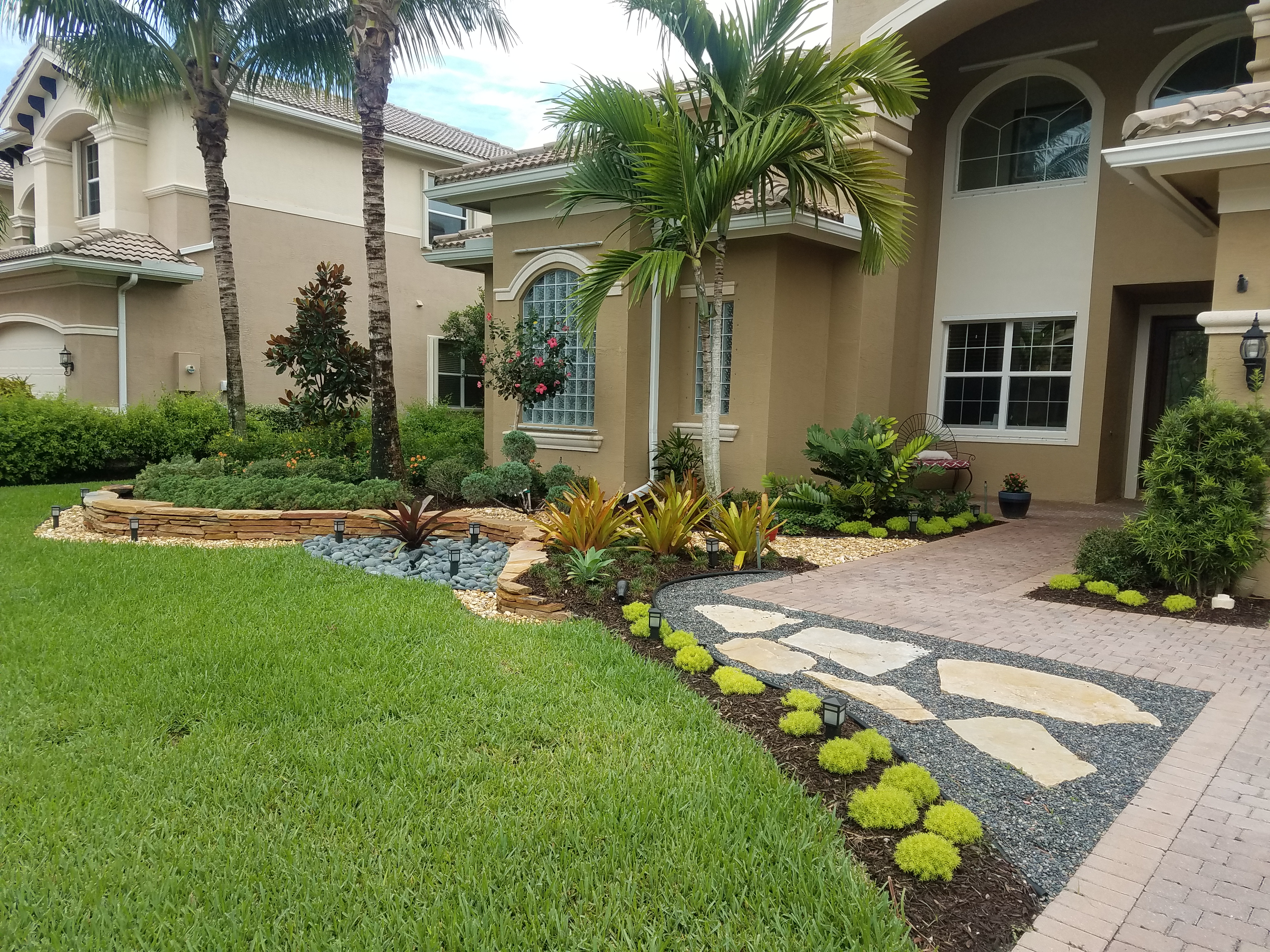 The Front Landscape Of This House With Decorative Stone Was Completely Re Done.  The Old Landscape, About 10 Years Old Was Removed In Hopes Of A Cleaner  Look ...