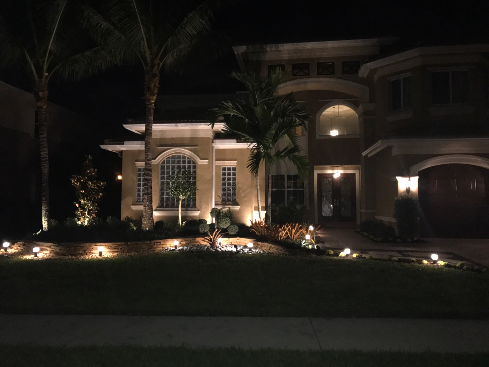 This front yard stone work with lighting shows how a yard can stand out even at night. The accents of the lighting highlight the stone wall u0026 the home to ... & front landscape stone work with lighting - Universal Landscape Inc. azcodes.com