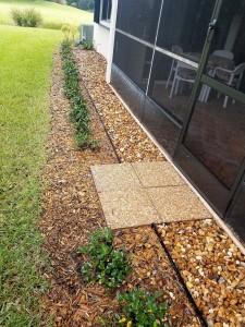 Stonework behind rear patio screen