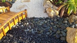 Landscape Design With Black Polished Stone & Small Step Bridge
