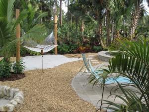 Hammock in Backyard With Tropical Landscape