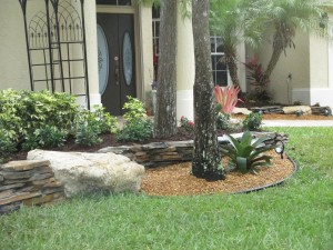 Decorative Flagstone Wall & Boulder in Landscape